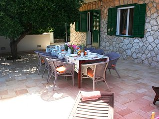 Spacious luxury villa just 50m from the beach, with large dining terrace