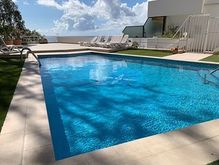 Fabulous views, all day sun on terrace, on-site pool, free Wifi and parking