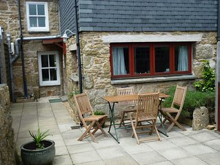 Cariad, a well appointed character cottage with private garden, close to beaches
