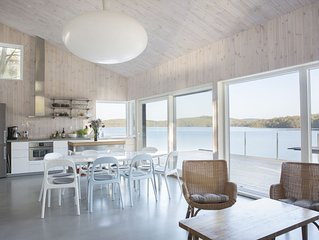 Designhus med egen brygga vid sjo
