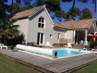 Villa 4 *,au calme, sur golf 27 trous,piscine chauffée,plages:lac, océan,