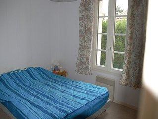 Appartement rez-de-chausse terrasse couverte et jardin privatif