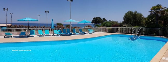 Spacious pool with tanning area located 2 from the beach.