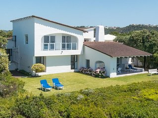 Wonderful holiday home right on Robberg Beach, Plettenberg Bay. Sleeps 8 people