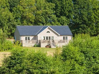 This delightful lodge on Wakes Hall Farm is a haven of peace in 500 acres of pri