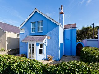 Detached family holiday home with enclosed garden just moments from the beach.