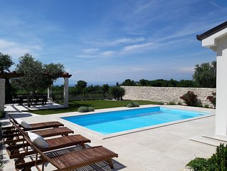 Villa with heated pool, beautiful sea view, above Malinska