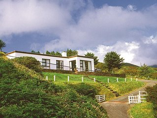 Detached modern bungalow facing south at the edge of the Slieve Mish Mountains,