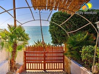 Bella casa con giardino ed ampia veranda a 10 metri dal mare di Seccagrande