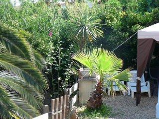Porticcio: appartement  indépendant en rez de jardin de villa, vue mer