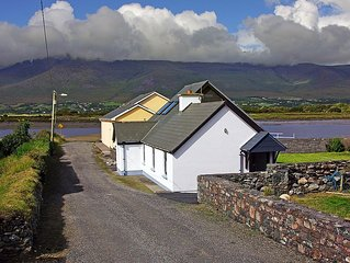 Detached cottage in fine location, at the end of the road right beside the pier,