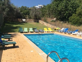 Spacious holiday apartment with shared pool, close to beach and all amenities.