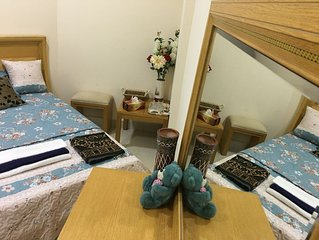 Large Room for couple in 2 bedrooms flat , guest can use the kitchen .