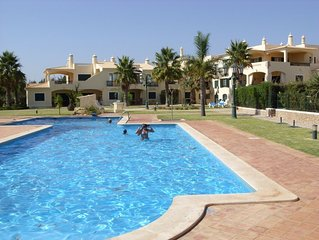 Superb Holiday & Golf Apartment with private garden. Swimming pool & child pool