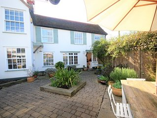 The cottage is quite heavenly and every room overlooks the pretty garden. It is