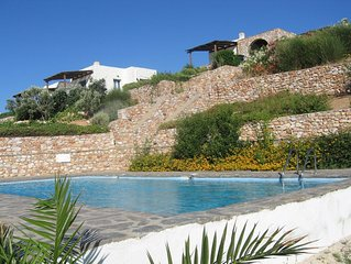 Luxury Villa with pool set in lush gardens with stunning view of bay.