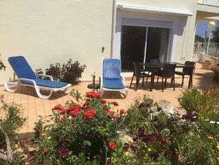 Peaceful, sunny, garden-apartment in select area