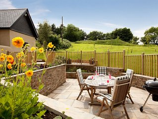 Relax in luxury at peaceful rural location with private woodland nature trail.