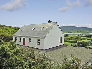 Detached bungalow (one of two) in elevated position, enjoying far reaching south
