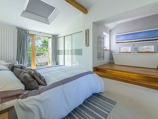 A contemporary four-bedroom cottage situated a short walk to Holme Beach.