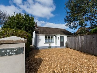 St Brides Cottage is a lovely two-bedroomed detached bungalow less than a quarte