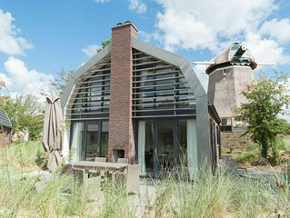 Stunning, new villa with sauna, surrounded by dunes and near the sea