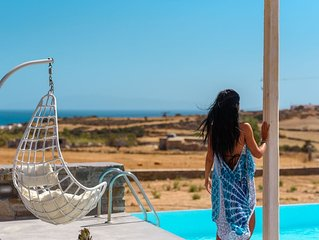 Cycladic Breeze villa is a charming swimming pool villa with great sea view