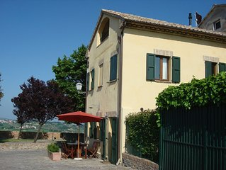 Uniquely situated, stunning, medieval village home with gorgeous panorama view