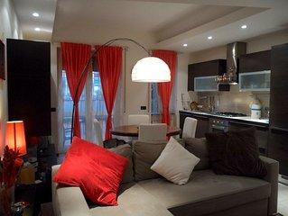 Appartamento con terrazza, giardino e parcheggio privato a pagamento