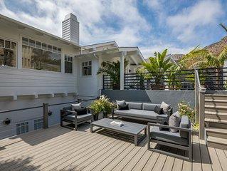 Walk to the best of Broad Beach.Designer home, great ocean views. Endless pool.