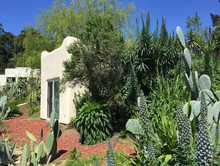 Adobe Casita with Colorful Garden View