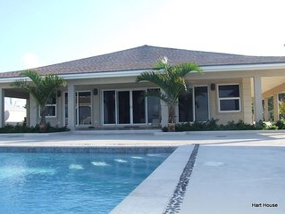 Hart House-Elegant Beachfront Home nearby Sandals Emerald Bay Exuma, Bahamas
