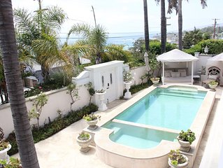 Chic Beach House on quiet street with pool & ocean views ...short walk to beach