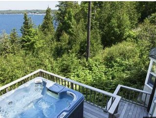 Charming home with AMAZING water views, shore access, hot tub and fireplace