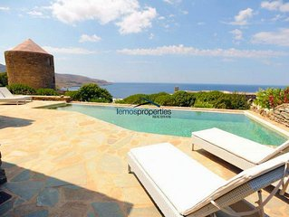 Stone built villa with a swimming pool and a fantastic sea view in Koundouros