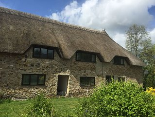 Spacious thatched barn-conversion cottage, with amazing on-site facilities