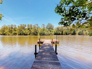 Secluded, waterfront home w/ a large yard, private dock, & water access!