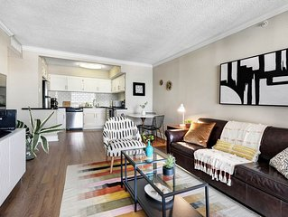 Spacious high-rise apartment w/ a shared pool, fitness room, & city view