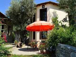 Quaint character cottage in traditional Greek village