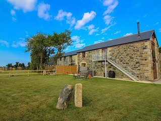 Situated close to the south-west Cornwall coast, with views down a rolling valle