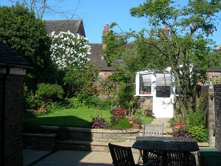 Garden Cottage is a listed, small town house on one of the loveliest streets.