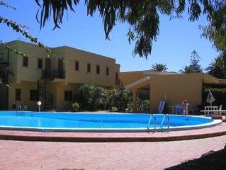 Appartamentino con veranda in residence con piscina e accesso al mare