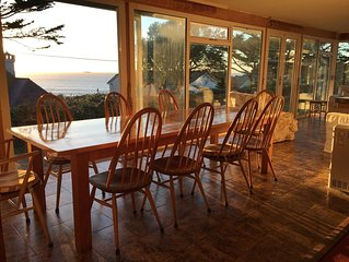 Seaside House, huge living room opens onto elevated lawn. 2-minute walk to beach