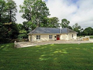 Renovated Gate Lodge (The Welcome Lodge) situated in wooded setting with large e