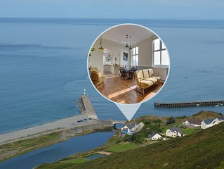 Perched on a rocky outcrop above the river Ystwyth, directly on the Wales Coasta