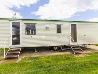 Dog friendly caravan for hire in Norfolk.On a brilliant holiday park.ref 50002aE
