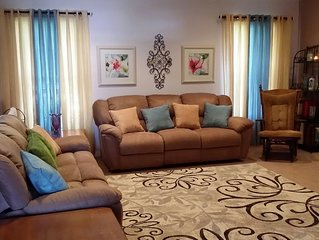 CLEAN Modern home, 3 bedrms, 1 double-sink bathrm,   65' TV  & 3 couches