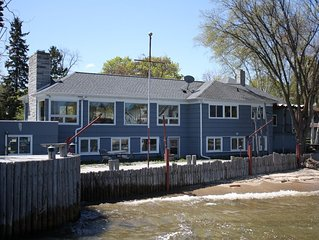 The Boat House with its own private dock and 140 feet of shorefront