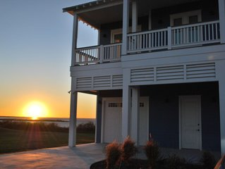 Brand new home located directly on Galveston Bay in Pointe West Community.