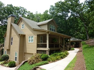 Beautiful 5 BR/4.5 BA lake home with outdoor kitchen and stone fire ring